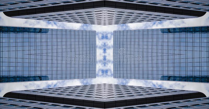 Skyscrapers in symmetry, abstract architecture. Skyscrapers in a symmetrical arrangement forming a passage, tunnel. Modern architecture in the abstraction of royalty free stock photography