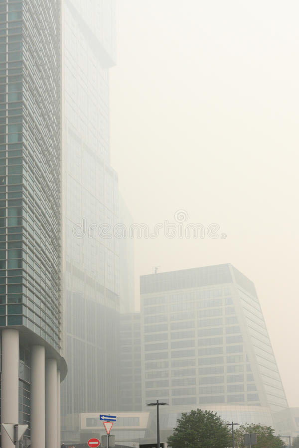 Skyscrapers Under The Heavy Smog stock photography