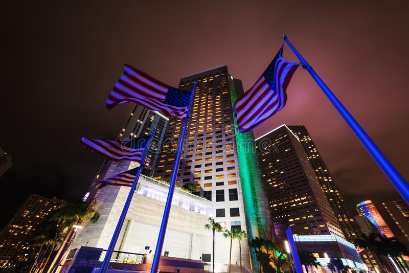 Skyscrapers and USA flags in Chopin Plaza at night. Miami, USA stock photography