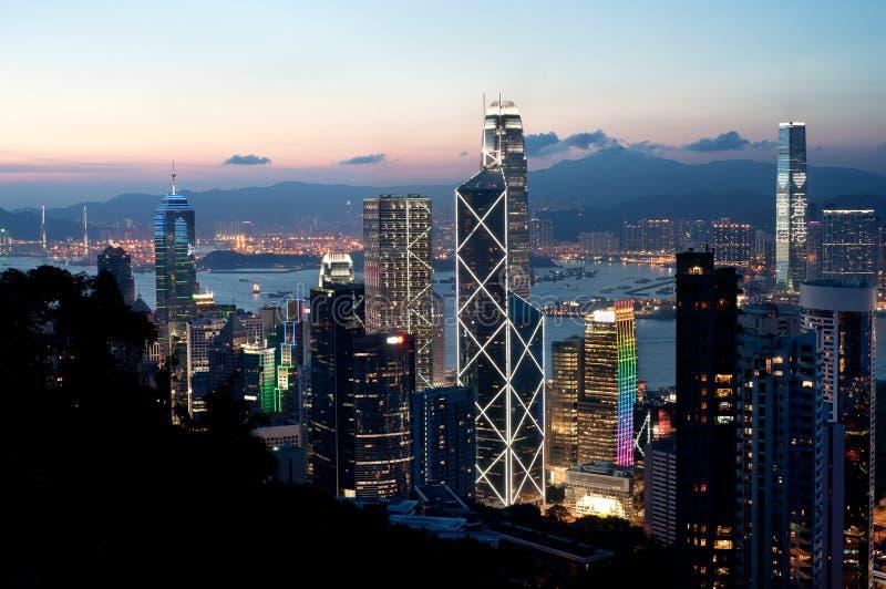 Skyskrapor för centralt område på solnedgången, Hong Kong Island arkivbild