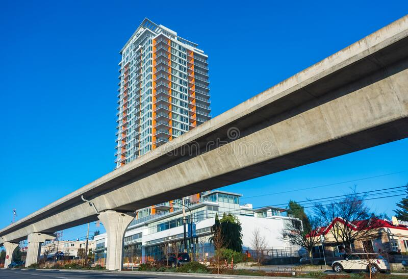Skytrain lane in front of residential tower building. Skytrain rail lane in front of residential tower building royalty free stock photo