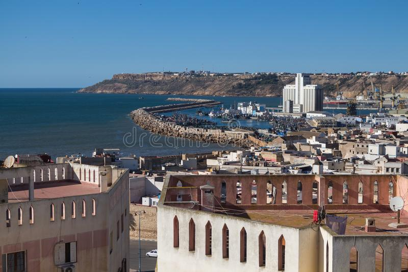 Skyview on industrial part of Safi, Morocco. Skyview on the old city and the industrial part of the port. Cliffs in the background. Water of the Atlantic ocean stock photo