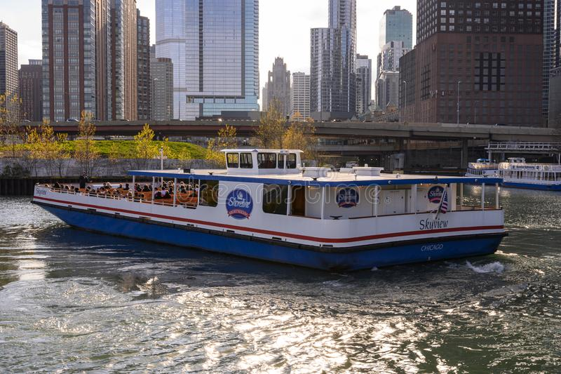 Skyview turning around. Chicago, IL, United States - May 9, 2019: Shoreline Sightseeing `Skyview` tour boat turning around near the Ogden Slip in Chicago royalty free stock image