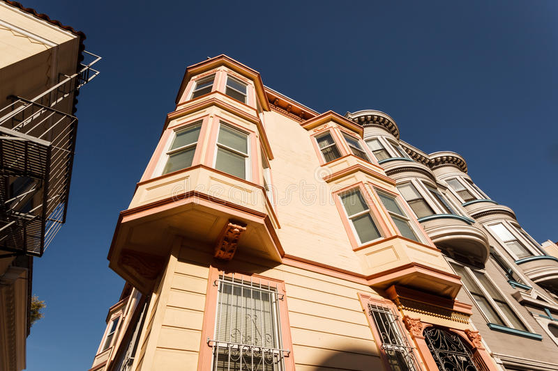 Skyward view of pretty bay windows on San Francisco house. Skyward view of pretty bay windows on San Francisco corner row house royalty free stock photography