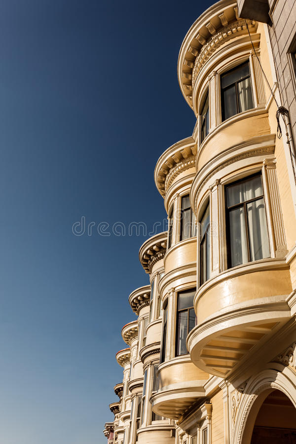 Skyward view of pretty bay windows on San Francisco house. Skyward view of details of pretty bay windows on San Francisco corner row house stock images
