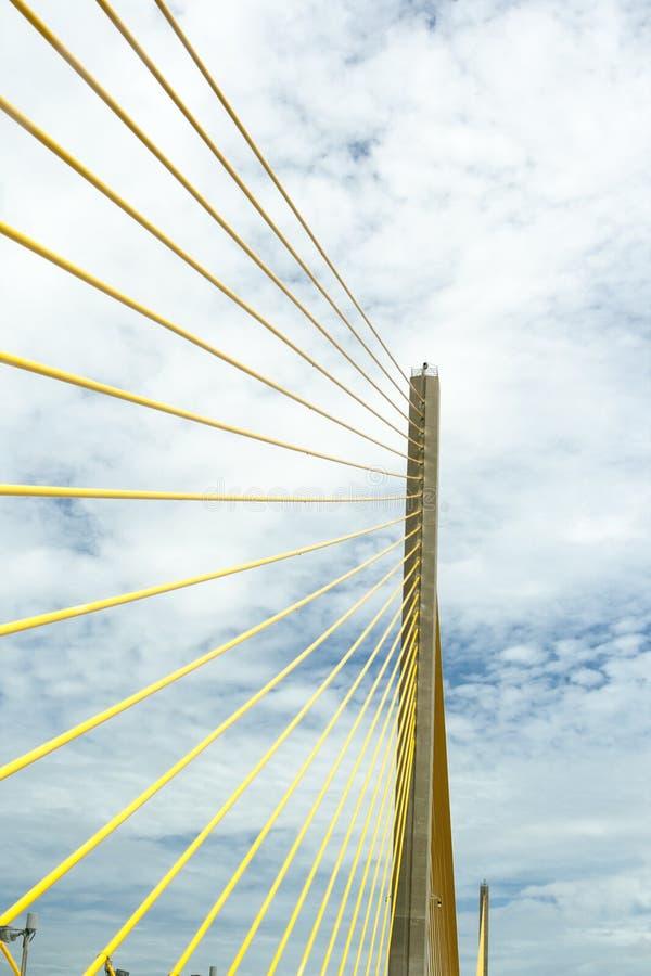 Skyway Bridge. Golden cables on Skyway Bridge,Florida, against cloudy background stock photography