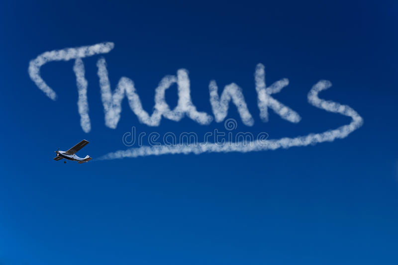 Skywriter Writing Thanks In The Sky Royalty Free Stock Photography