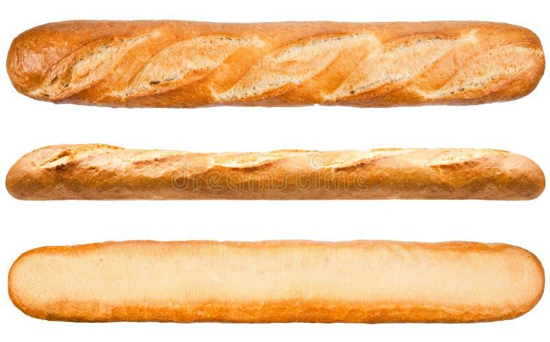 släntra long Franskbröd som isoleras på den vita bakgrunden arkivbild