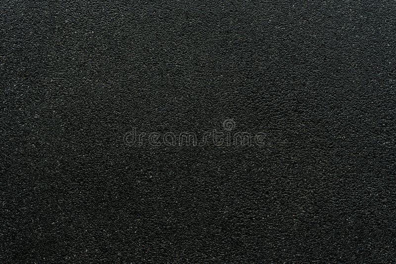 Slät asfaltväg Texturen av grova asfaltbeläggningen, arkivfoto