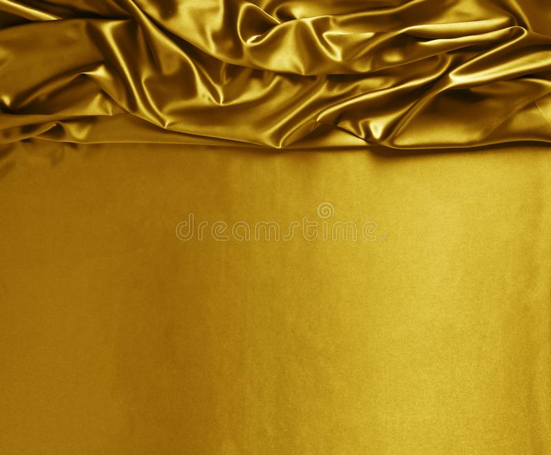 Sl?t elegant guld- silke- eller sat?ngtextur arkivbilder