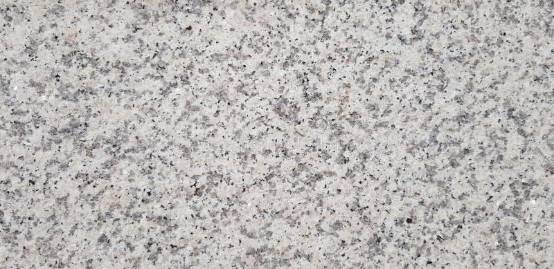 Slät yttersida av grå färger marmorerar fotoet textur royaltyfri bild