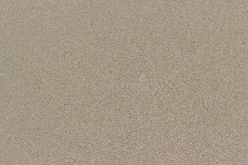 Slät yttersida av våt sand arkivfoto