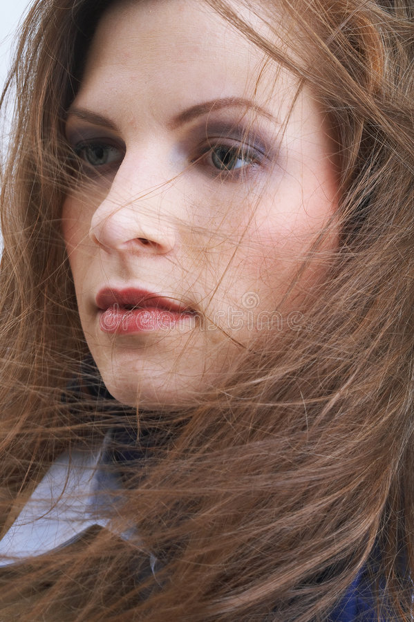 slår hår henne wind royaltyfri bild