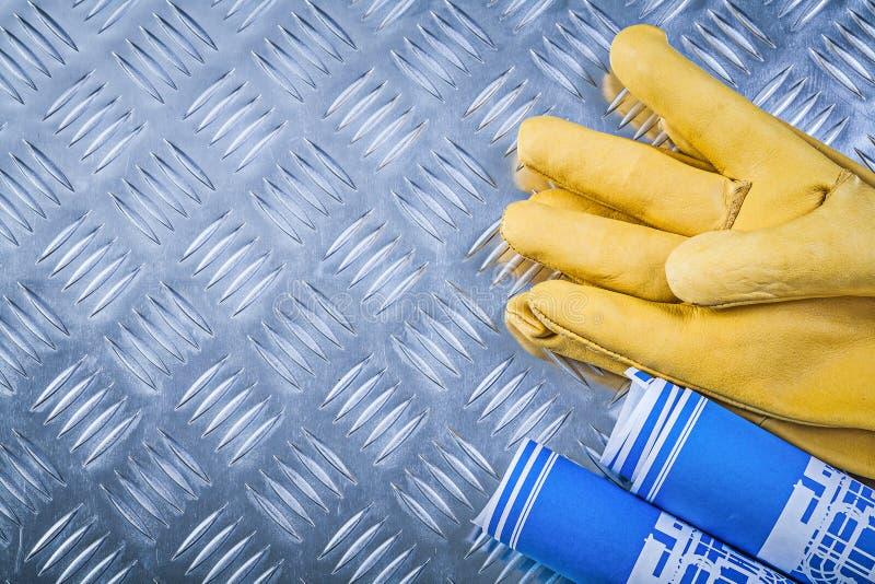Slösa rullande handskar för läder för teknikteckningar skyddande på Co fotografering för bildbyråer