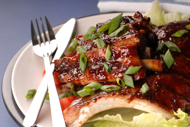 Slab of BBQ ribs. A slab of BBQ ribs with scallions royalty free stock image