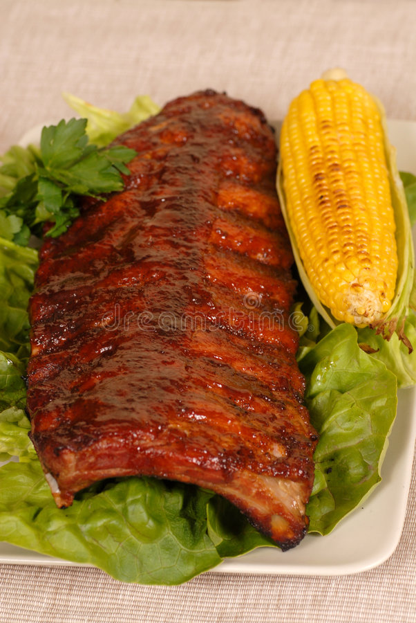 Slab of ribs with ear of corn royalty free stock photos