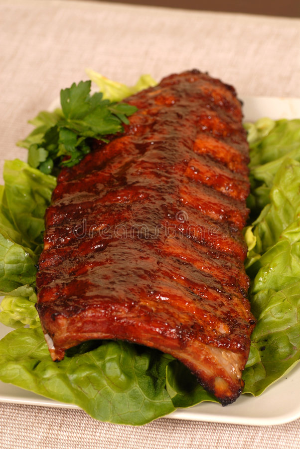 Slab of ribs on lettuce royalty free stock photo