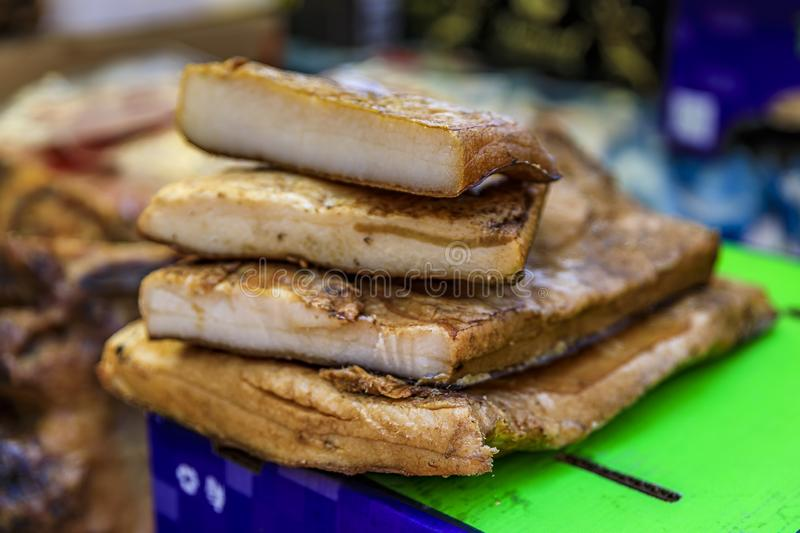 Slabs of cured and smoked pork belly fat on display at a market in Kotor Montenegro, traditional Montenegrin cuisine stock photo