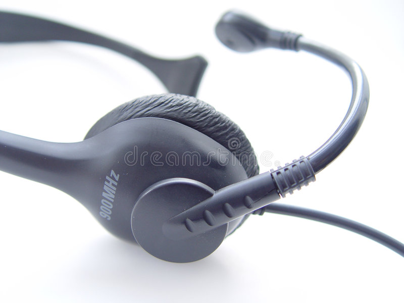 sladdlös hörlurar med mikrofontelefon arkivbild
