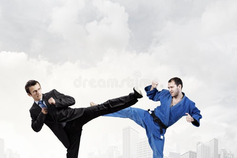 Slag van twee tegenstanders stock foto's