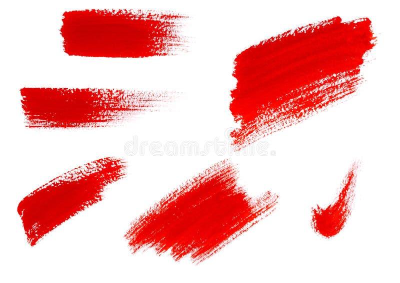 Slagen van rode die verf op witte achtergrond worden geïsoleerd stock afbeeldingen