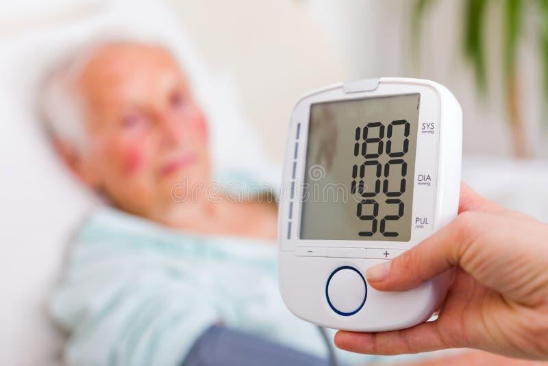 Slaggevaar - hoge bloeddruk stock fotografie