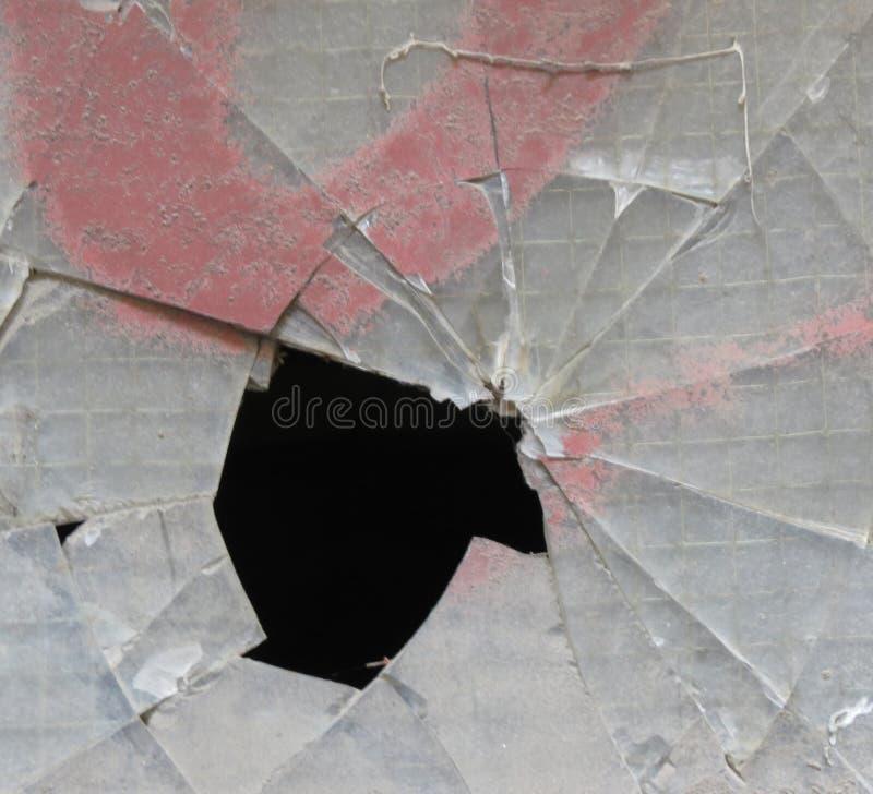 Slagit f?nsterexponeringsglas arkivfoto