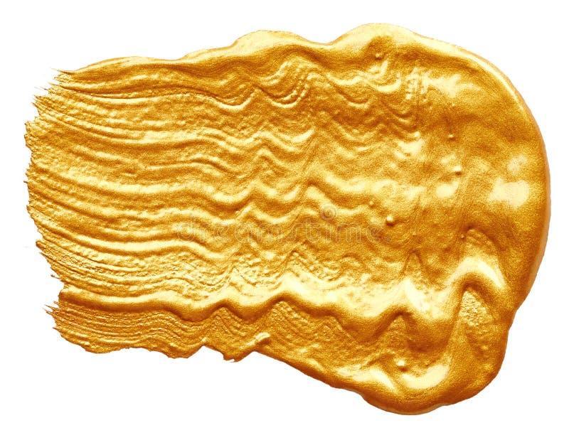 Slaglängder av guld- målarfärg fotografering för bildbyråer