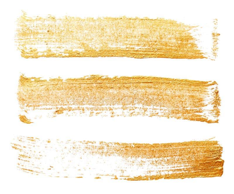 Slaglängder av guld- målarfärg royaltyfria bilder