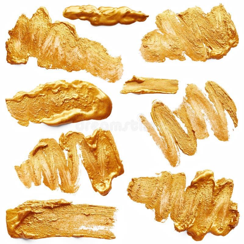 Slaglängder av guld- målarfärg royaltyfria foton