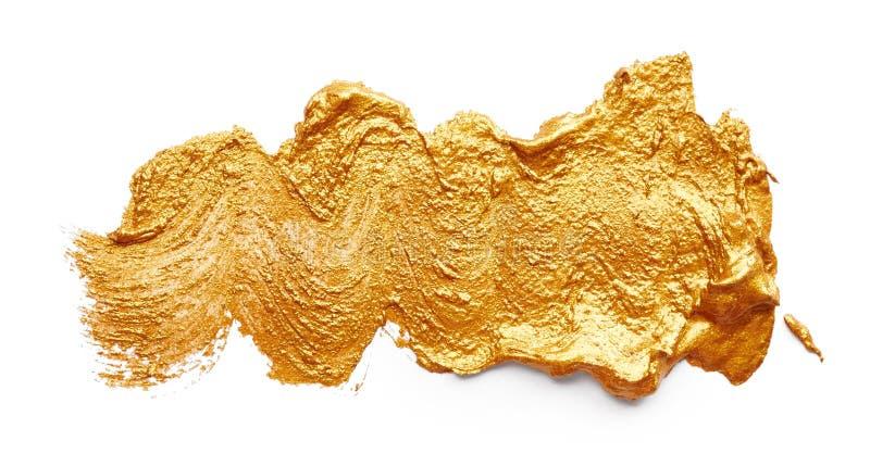Slaglängder av guld- målarfärg arkivfoto