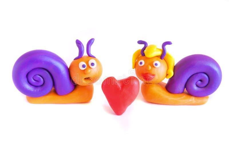 Slakken in liefde, klei modellering. stock foto's