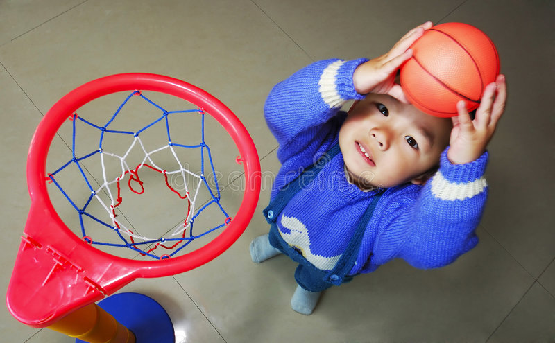 Slam dunk. Boy try to slam dunk royalty free stock photos
