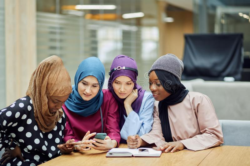 Slamic female travel blogger sharing info from smartphone with her followers. Islamic female travel blogger sharing info from smartphone with her followers while stock photo