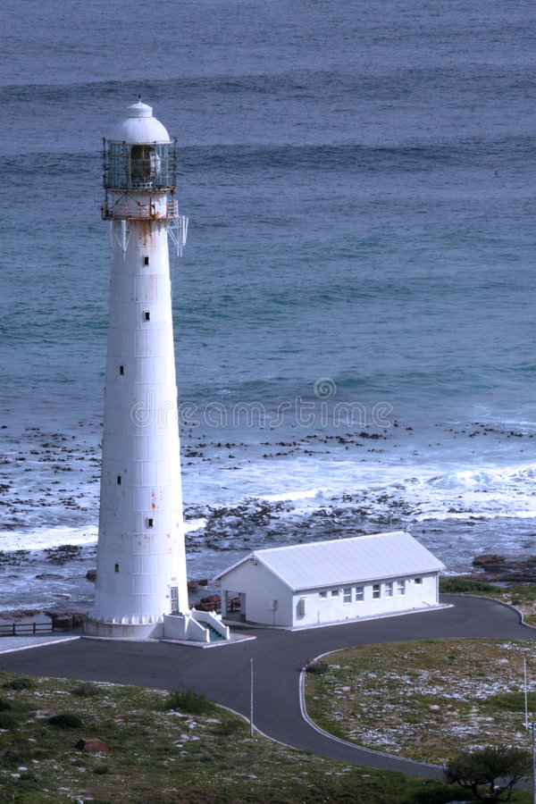 The Slangkop lighthouse. In the village of Kommetjie in Western Cape in South Africa stock image
