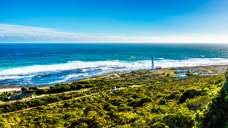 Slangkop Lighthouse on the Atlantic coast along the road to Chapman`s Peak in the Cape Peninsula. Slongkop Lighthouse at the Atlantic coast along the road to stock photography