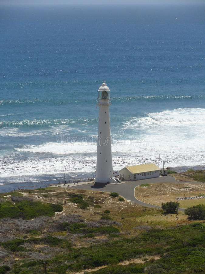 Slangkop Lighthouse or Kommetjie lighthouse. Stunning view of the historical Slangkop lighthouse from Chapman's Peak road at Kommetjie in the Western Cape, South royalty free stock images