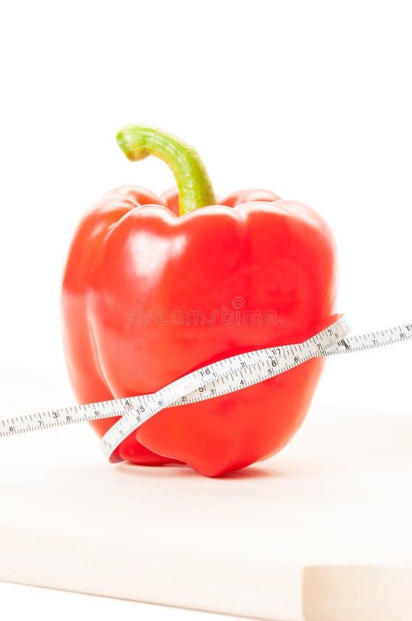 Slank dieet met Spaanse peperconcept stock afbeelding