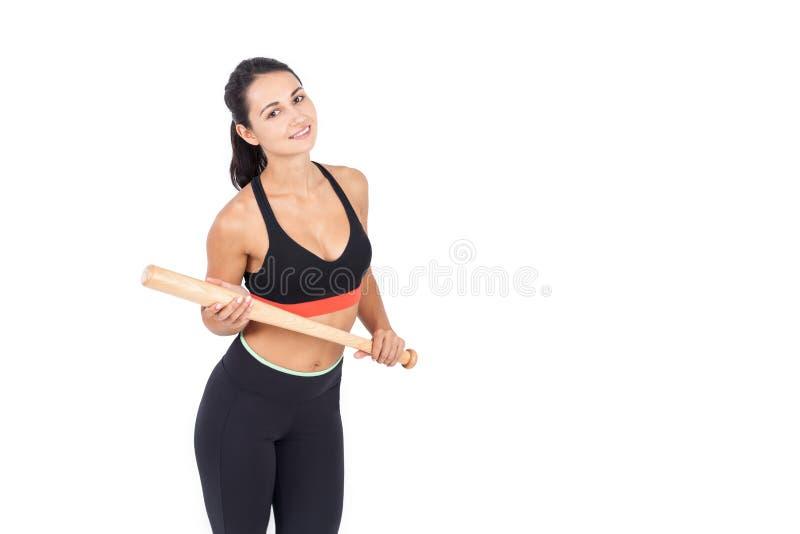 Slank flicka med baseballslagträet royaltyfria bilder