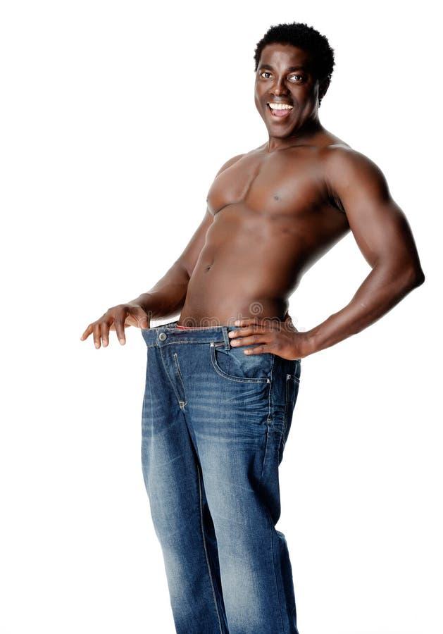 slanka weighloss för man arkivfoto