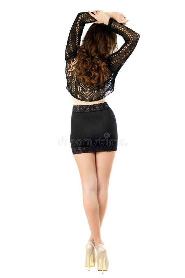 Slanke brunette die terug possing royalty-vrije stock afbeelding