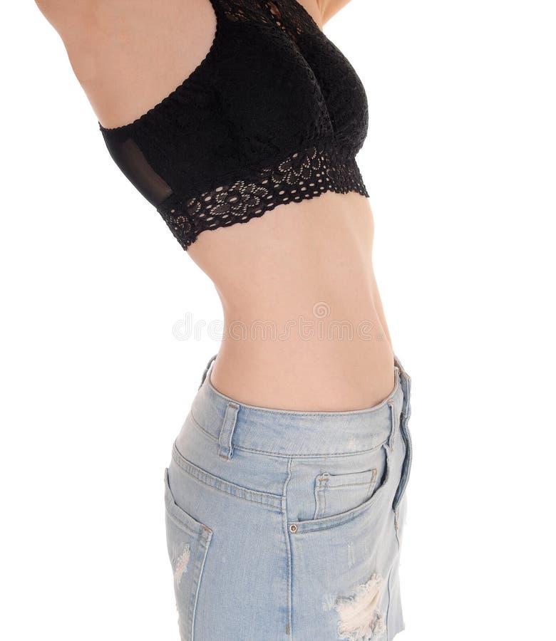 Slanke maag en uiteinde van jonge vrouw stock foto