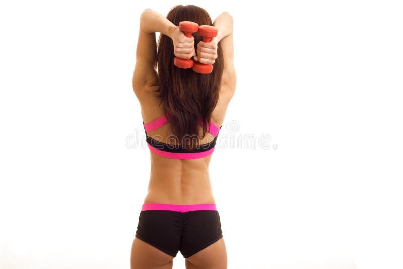 Slanke sexy atletische meisjeswaarde terug naar de camera en de holding een domoor royalty-vrije stock afbeelding