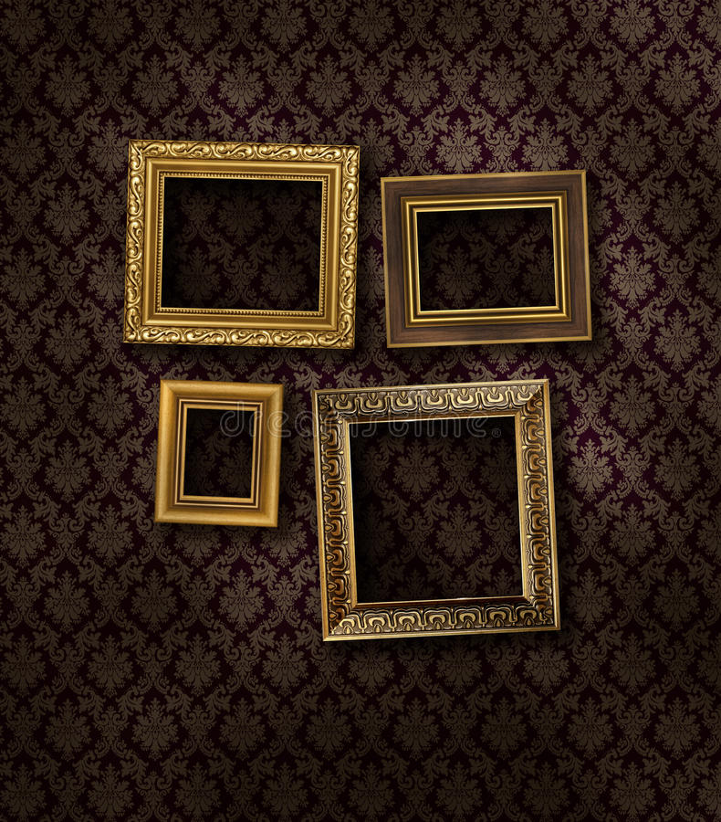 Slanted gilded frames. On dark damask pattern wall paper stock photo