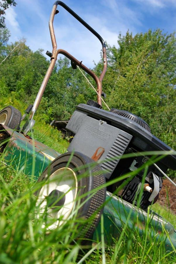 Slanted lawn mower royalty free stock photos
