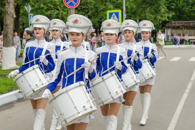 Slantsy, Leningrad region, Russia, July 30, 2016: Girls drummers in military uniform at the festival 89-th birthday of the Leningr. Ad region stock image