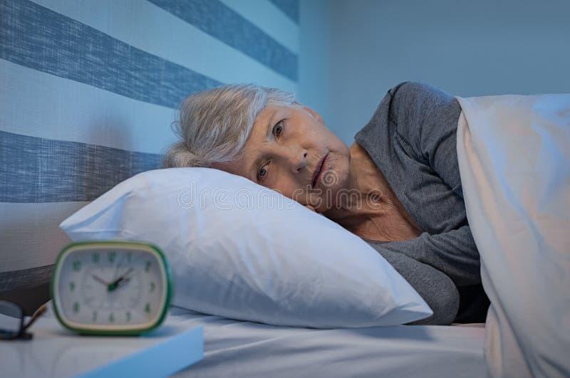 Slapeloosheid bij nacht stock afbeelding