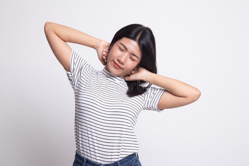 Slaperige jonge Aziatische vrouwengeeuw stock foto