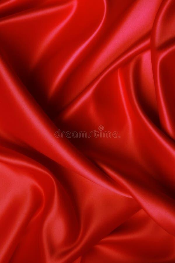 slapp röd satäng royaltyfri bild