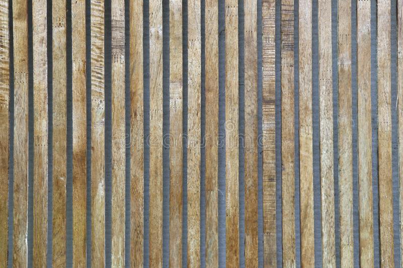 Slat background, arranged in a space between each other. Wood strip arranged vertically royalty free stock photography
